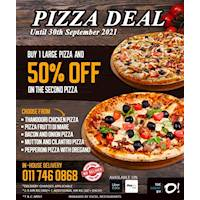 Buy 1 Large Pizza and 50% off on your second pizza at The Shore By O